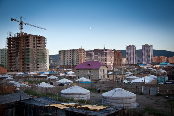 nomads' ger scattered at the feet of modern high rise condominiums on the outskirts of Ulaan Baatar