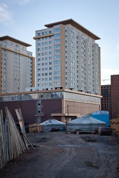 Ger sit beneath modern condominiums in Ulaan Baatar